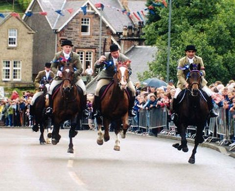 Riders returning from riding the Selkirk Marches gallop in at The Toll