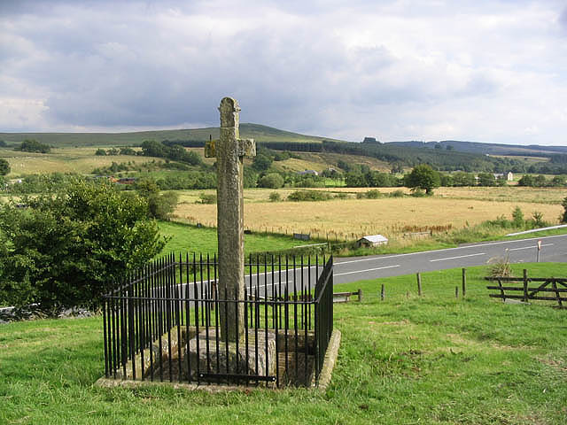 The Milnholm Cross A 2.5m high stone cross by the B6357 erected to commemorate an Armstrong laird who was killed at Hermitage Castle