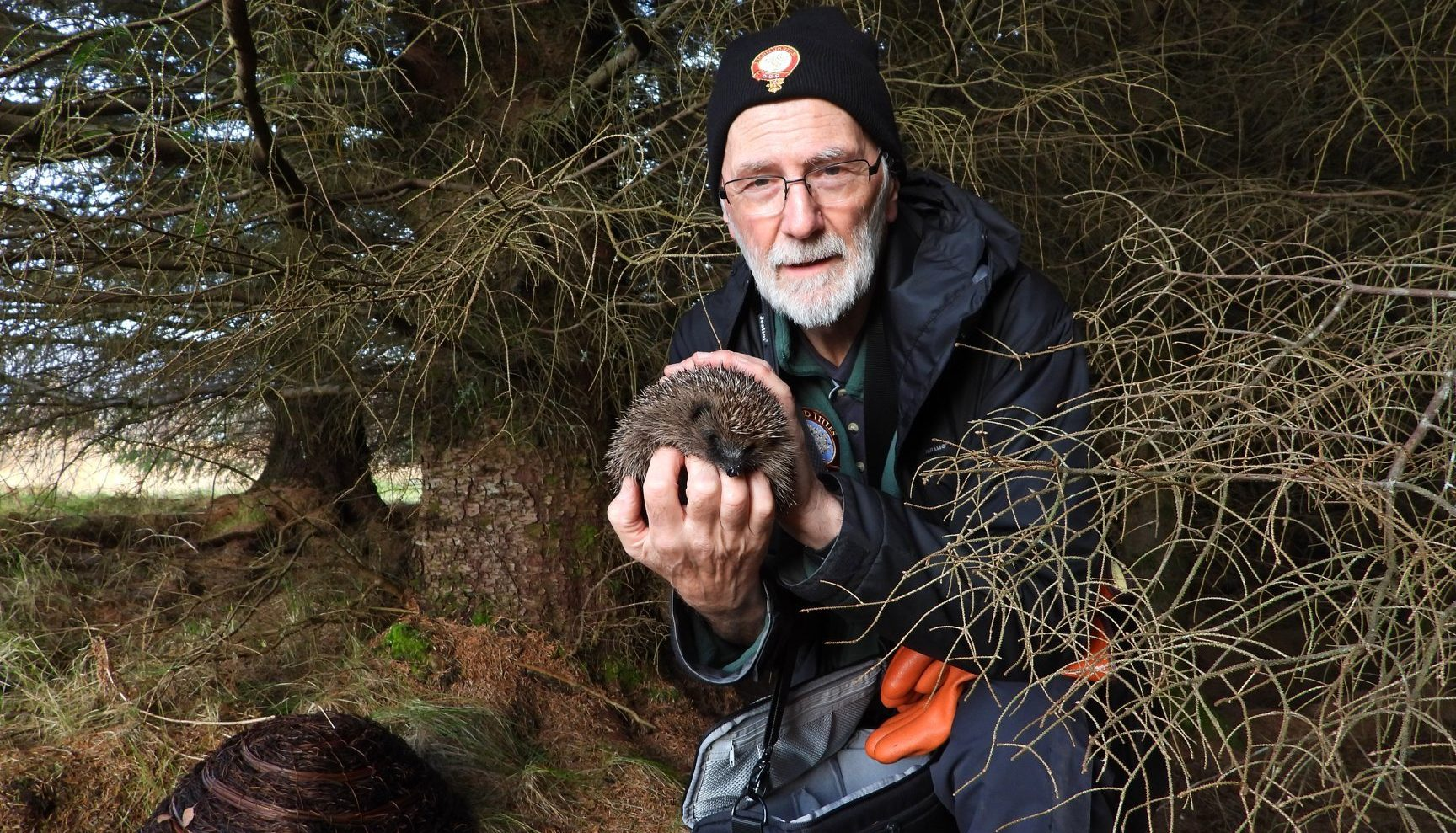 Stewart, the Reserve Warden, holding a hedgehog in the Sanctuary