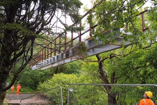 Bridge being lowered down to the cycle path
