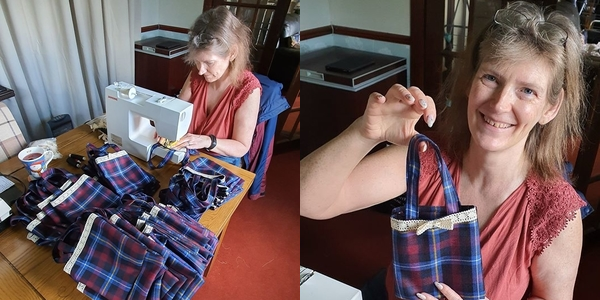 Fiona holding the new style goody bags for the 2020 Gathering