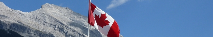 Canada's Flag in front of a mountain
