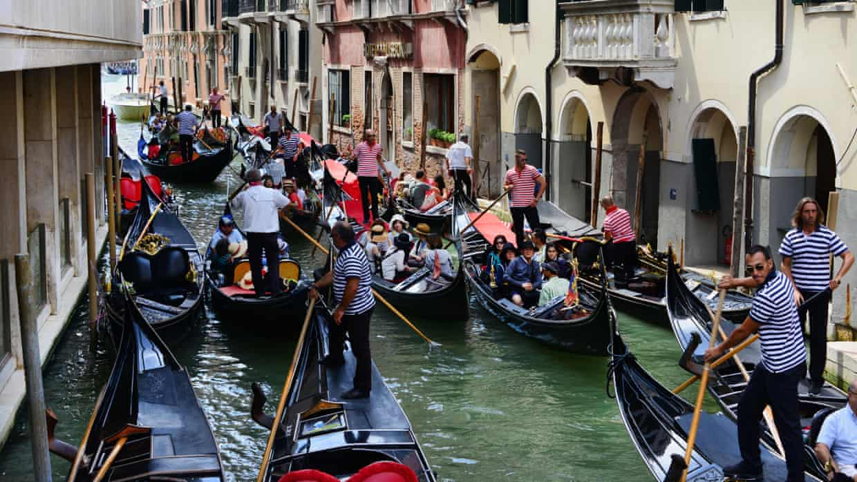 Busy Venice Canal Full of Gondoliers
