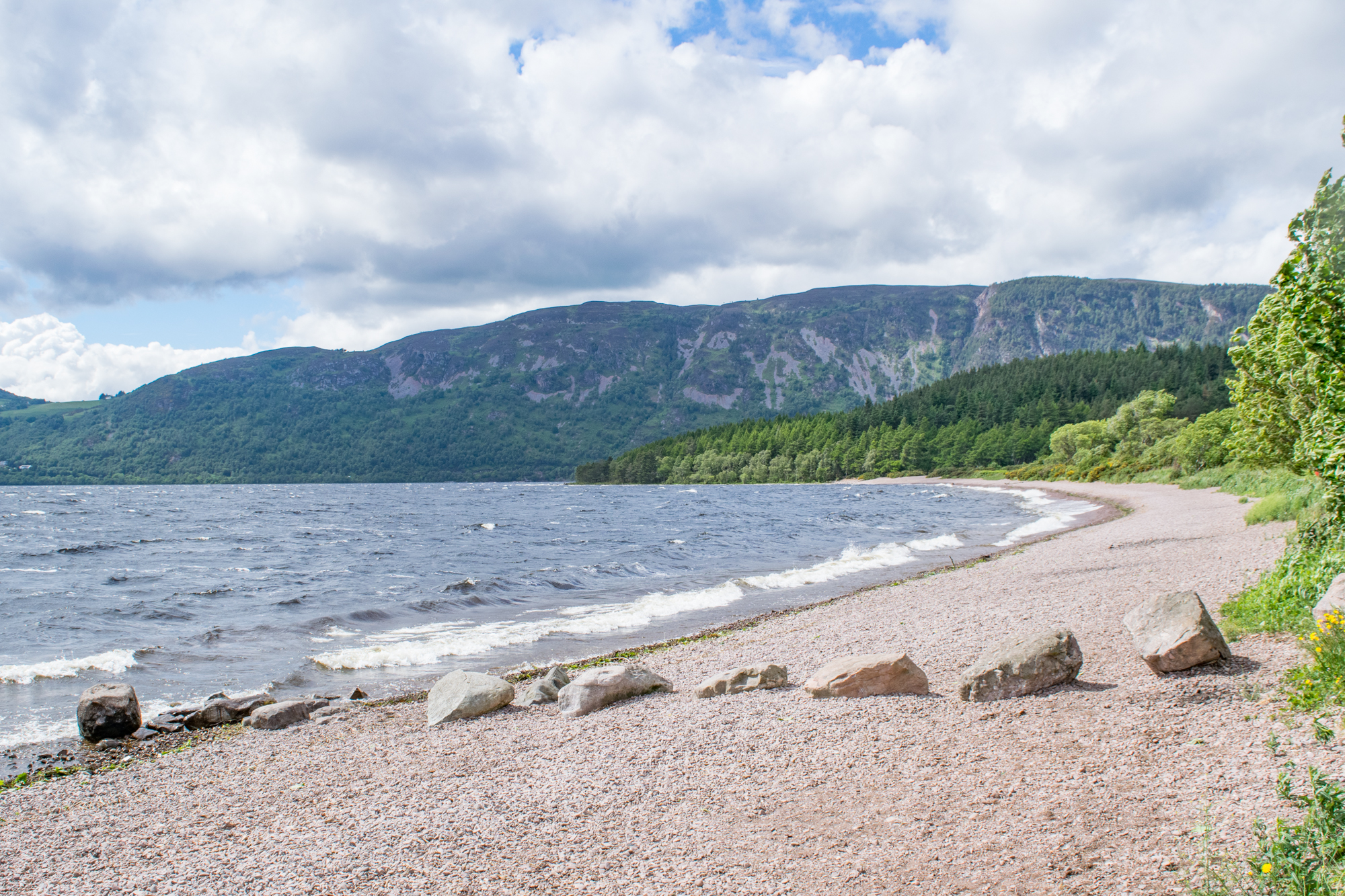 The pebbly beach on the shores of Loch Ness at the Dores Inn