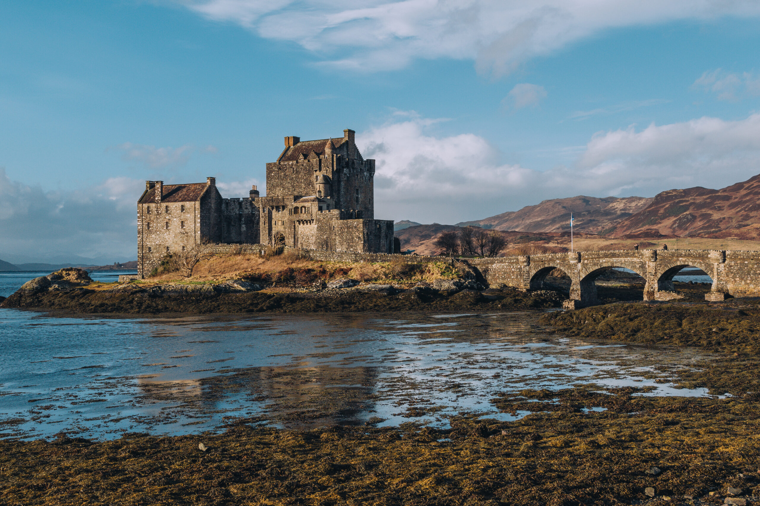 View of Eilean Donan Castle and the wee bridge across the water