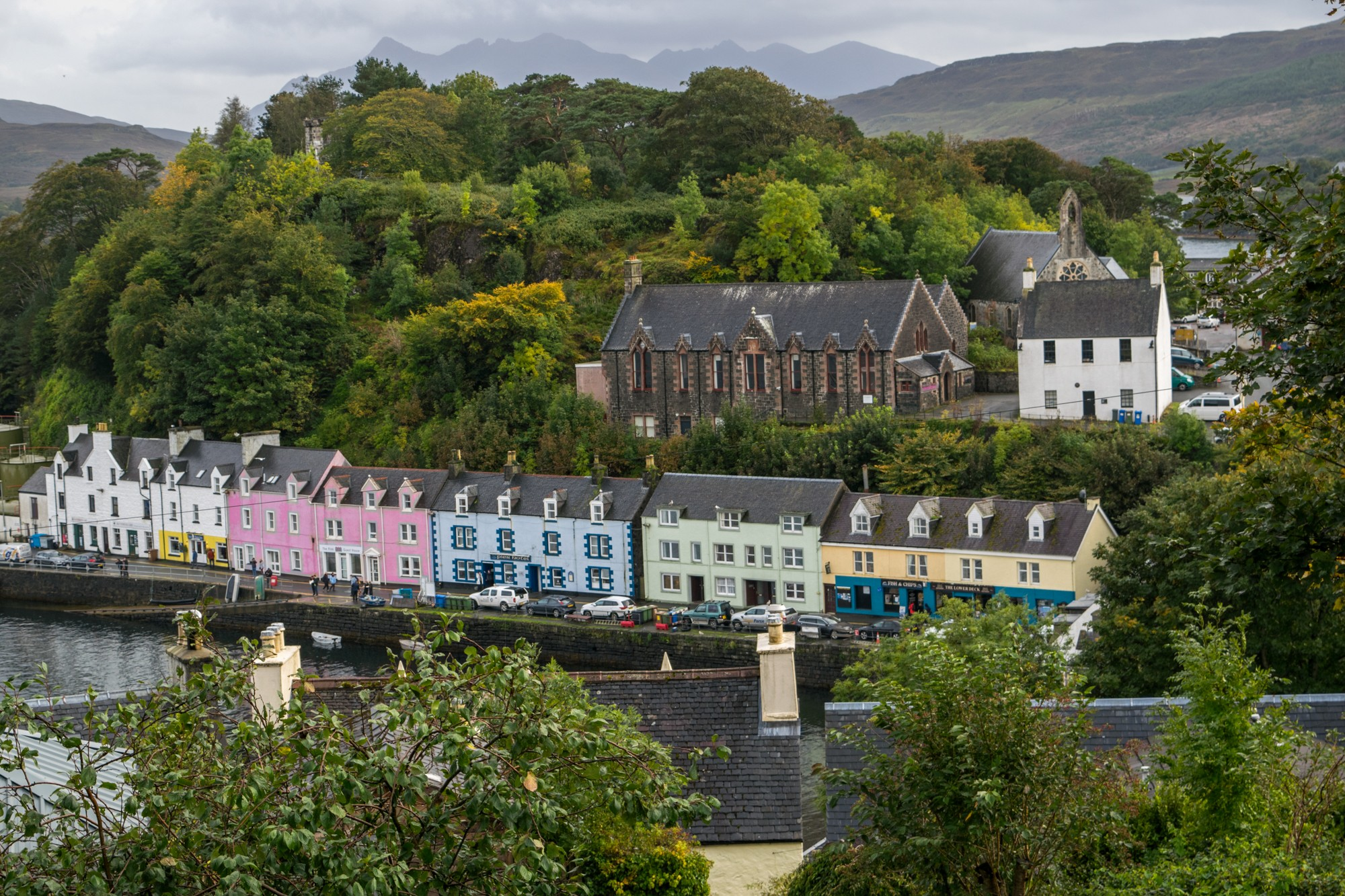 View of the colourful harbour in Portree